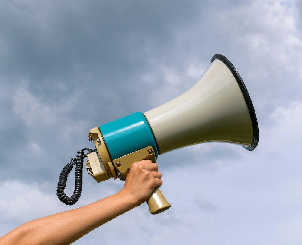 A,Female,Hand,Holds,A,Megaphone.,Horn,Loudspeaker,Is,Big